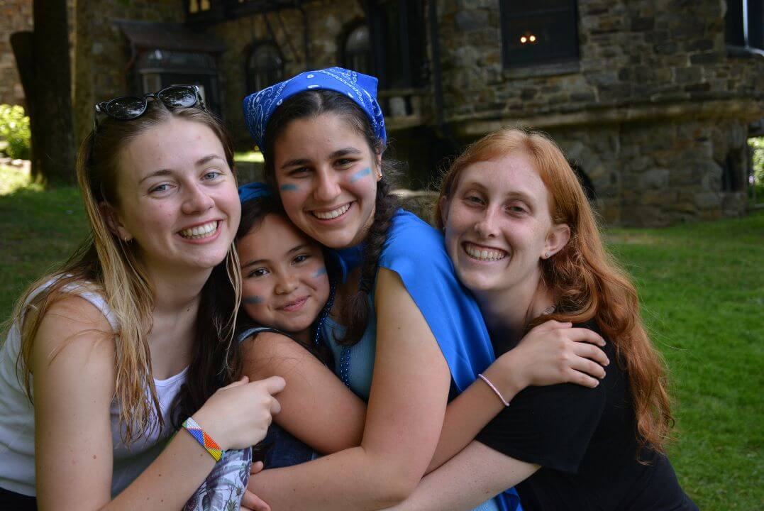 Summer Girls Camp - camper counselor hug